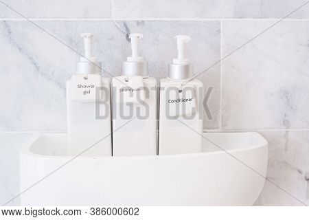 Toiletries Bottles In Bathroom At Luxury Hotel Or Modern Home. White Shower Container Set, Body Show