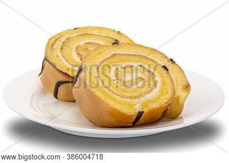 Sliced Cake Roll In White Ceramic Plate On White Background With Clipping Path.