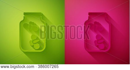 Paper Cut Fireflies Bugs In A Jar Icon Isolated On Green And Pink Background. Paper Art Style. Vecto