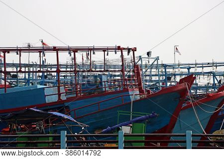 Many Fishing Boats Moored In The Port Harbor, More Than Hundred Indonesia Fishing Boat Docked At The