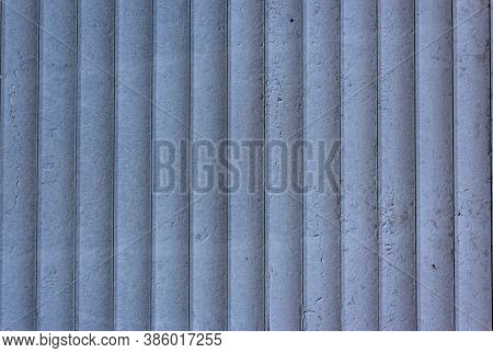 Background Of Blue Vertical Metal Strips With Peeling Paint. Roller Blinds And Garage Gates. Closed