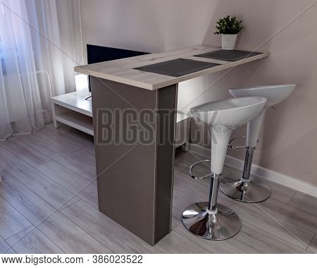 The Apartment With A Bar And High Bar Stools
