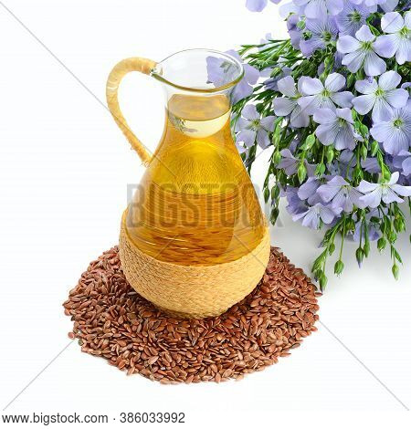 Jug With Linseed Oil, Flax Seeds And Flowers Isolated On White Background. Concept - Alternative Med