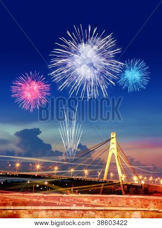 firework over Moskovsky bridge in Kiev city at night