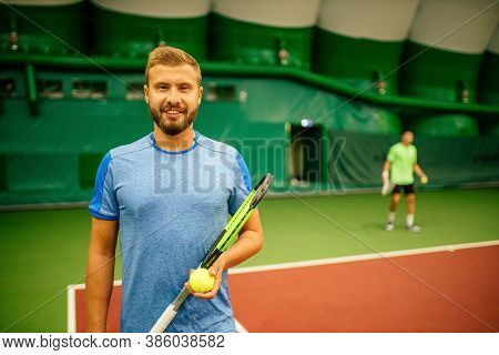 Professional Tennis Traner Player Playing A Game