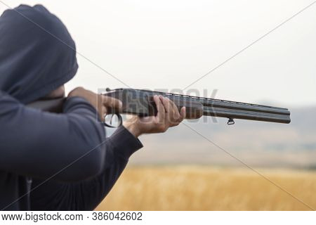 Male hunter ready to hunt with hunting rifle.hunter Holds a rifle.The hunter charges the rifle