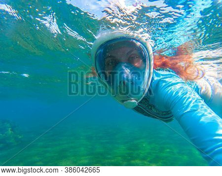 Red Hair Woman In Snorkeling Mask Underwater Photo. Tropical Island Lagoon Snorkeling And Diving Con
