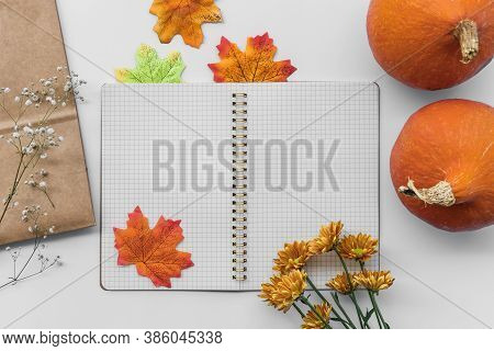 Blank Open Notepad, Diary Mockup With Two Orange Pumpkins And Dried Leaves And Flowers On White Back