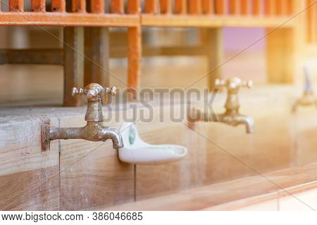 Old Faucet In Row,old Valve Faucet With Dirty Blass Faucet In Old Tub On School Children