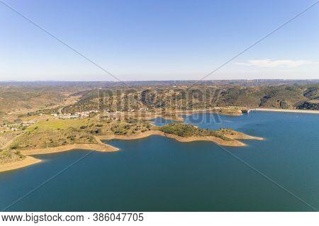 Aerial Drone View Of Barragem De Odeleite Dam Reservoir In Alentejo, Portugal