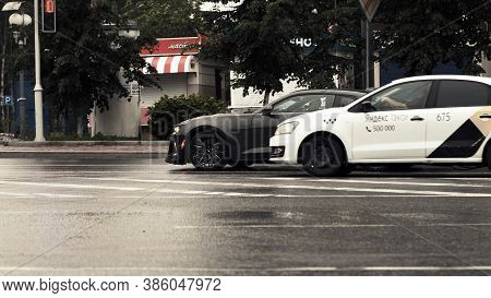 Tomsk, Russia - June 2, 2020: Chevrolet Camaro Zl1 Stands At A Traffic Light And A Taxi Is Passing