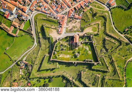 Mourao Drone Aerial Top View Of Star Shapped Castle With Alqueva Dam Lake Behind In Alentejo, Portug