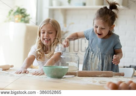 Cute Girls Discovering The World Of Cooking