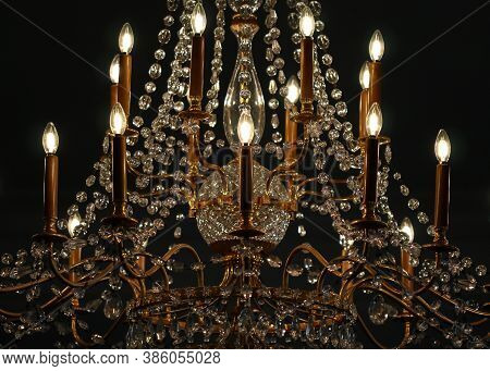 Historic Large Cristal Chandelier With Electric Bulbs Hanging In One Of Chambers Of Royal Castle In