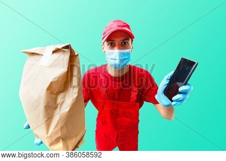 Delivery Man In Cap K T-shirt Uniform Face Mask Gloves Hold Cardboard Box Isolated On Color Backgrou