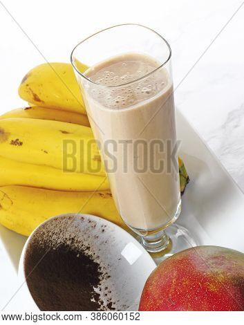 Homemade Smoothie With Banana, Mango And Cocoa