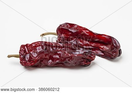 Two Dried Bell Peppers Isolated On White