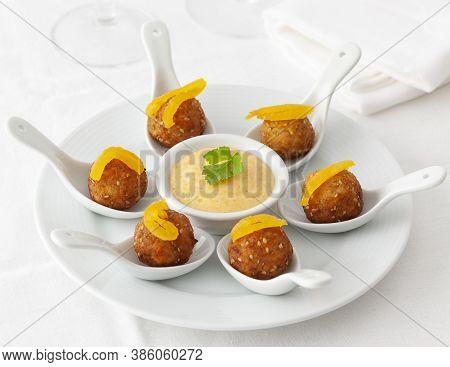 Vegan Meatballs With Sesame Seeds And Sauce