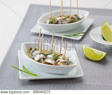 Tapas Food: Marinated Anchovies Served With Lime.
