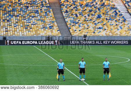 Kyiv, Ukraine - August 5, 2020: Referee Ivan Kruzliak (slovakia) And His Assistants On The Pitch Bef