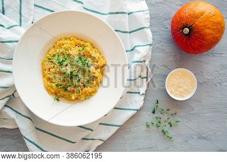 Delicious Pumpkin Risotto On Grey Concrete Background. Autumn Tasty Food, Top View.