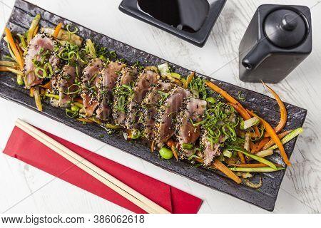 Japanese Food. Tuna Tataki. Seared Tuna With Sesame Seeds And Soy Sauce, Wasabi, Lime.