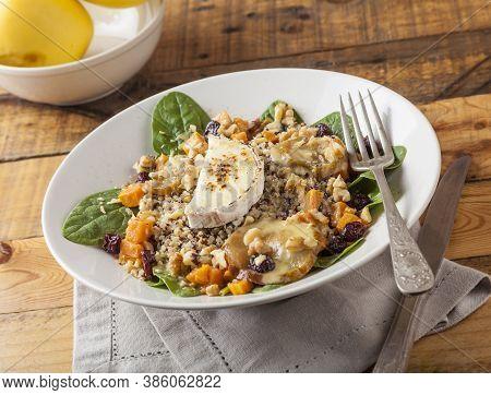 Quinoa Salad Served On Vintage Wooden Table