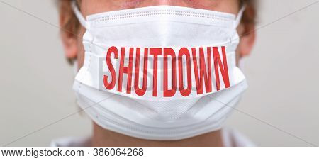 Shutdown Coronavirus Theme With Person Wearing A Protective Surgical Face Mask