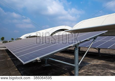 Solar Panels Or Solar Roofs Installed On The Building Rooftop.