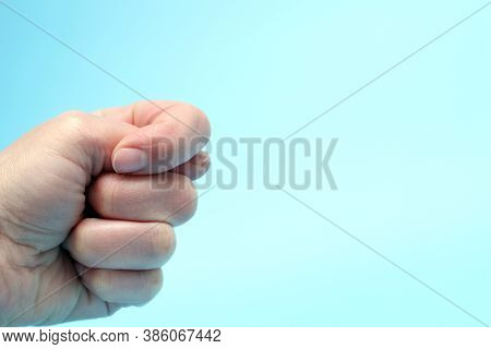 The Hand Shows A Fig Gesture Isolated On A Blue Background. Not Give. The Absolute Value, The Fig, T