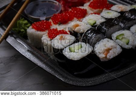 Close Up Of Sushi Rolls On Black Plate, Close Up