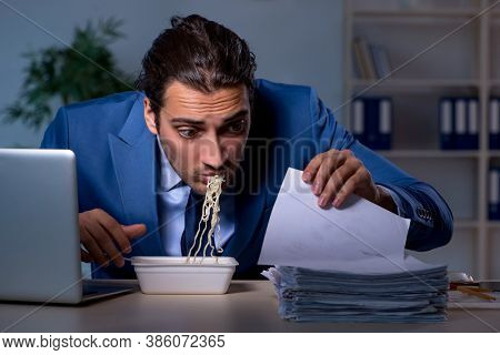 Hungry employee working late in the office