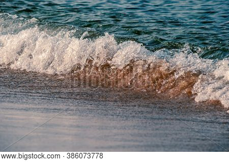 Tranquil Scene Of Pacific Ocean Waves Rolling Onto A Peaceful Beach