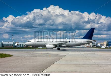 Passenger Airplane On The Runway With A Beautiful Textured Sky