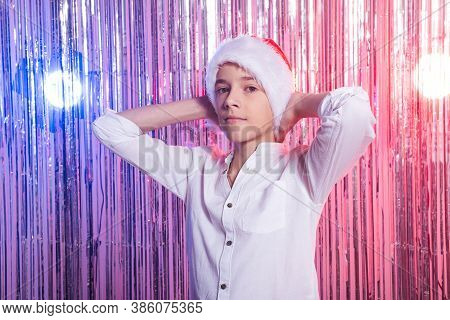 Christmas Time. Teen Boy With Santa Claus Hat Over Shiny Festive Background. Christmas Holidays Conc