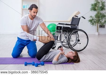 Leg injured woman doing sport exercises with personal coach