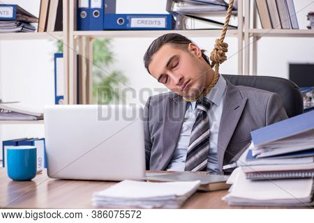 Young male employee committing suicide at workplace