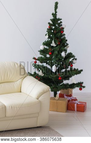 Holidays, Celebration And Home Concept - Living Room With Christmas Tree And Presents Background.