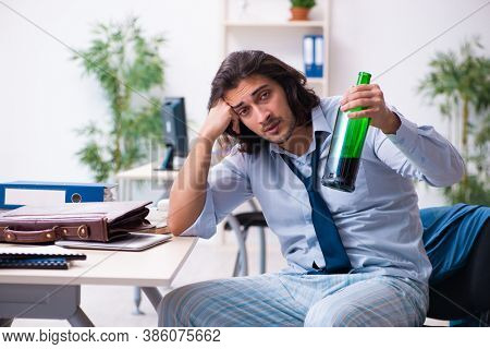 Male employee coming to work after party