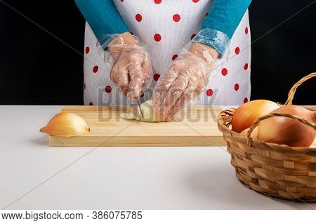 A Woman Cuts A Bow On A Wooden Cutting Board.
