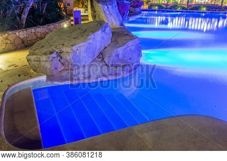 Cancun, Yucatan Peninsula, Mexico, October 31, 2015: Outdoor Swimming Pool at Night in Iberostar Resort.