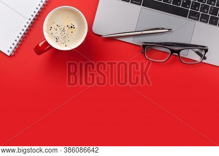 Office Red Workplace Backdrop With Coffee Cup, Supplies And Computer. Flat Lay. Top View With Copy S