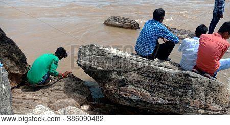 City Jabalpur, India - August 18, 2019: Indian Village People Sitting At Narmada River Bank In Bheda