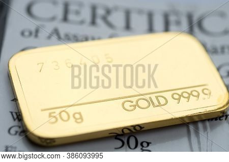 Minted Gold Bar Weighing 50 Grams 999.9, Fineness With Certificate. Gold Ingot With Assay Certificat