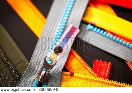 Zip Background Texture Of Zippers Sliders. A Lot Of Zippers In Different Colors. Sewing Clothes, Ate