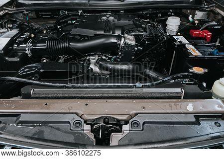 Novosibirsk, Russia - September 19, 2020: Mitsubishi Pajero Sport, Car Engine Close-up. Internal Com