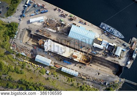 Shipbuilding Construction Ship In Dry Dock Aerial View At Shipyard Harbour With Scaffold