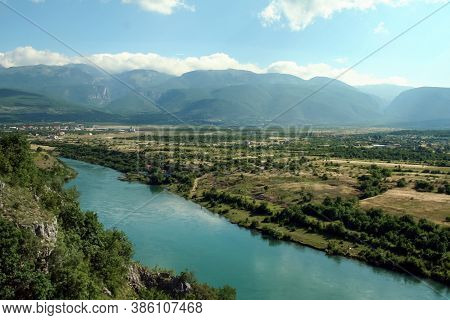 Neretva River In A Valley Near The City Of Mostar (bosnia And Herzegovina) With Mountains And A Few