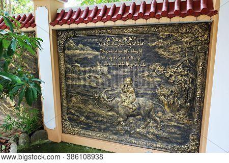 Hoi An, Vietnam, September 20, 2020: Bronze Relief In The Garden Of Tinh Xá Ngoc Cam Temple. Hoi An,