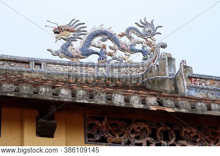 Hoi An, Vietnam, September 20, 2020: Dragon On The Roof Of The Temple In The Backyard Of The Van Mie